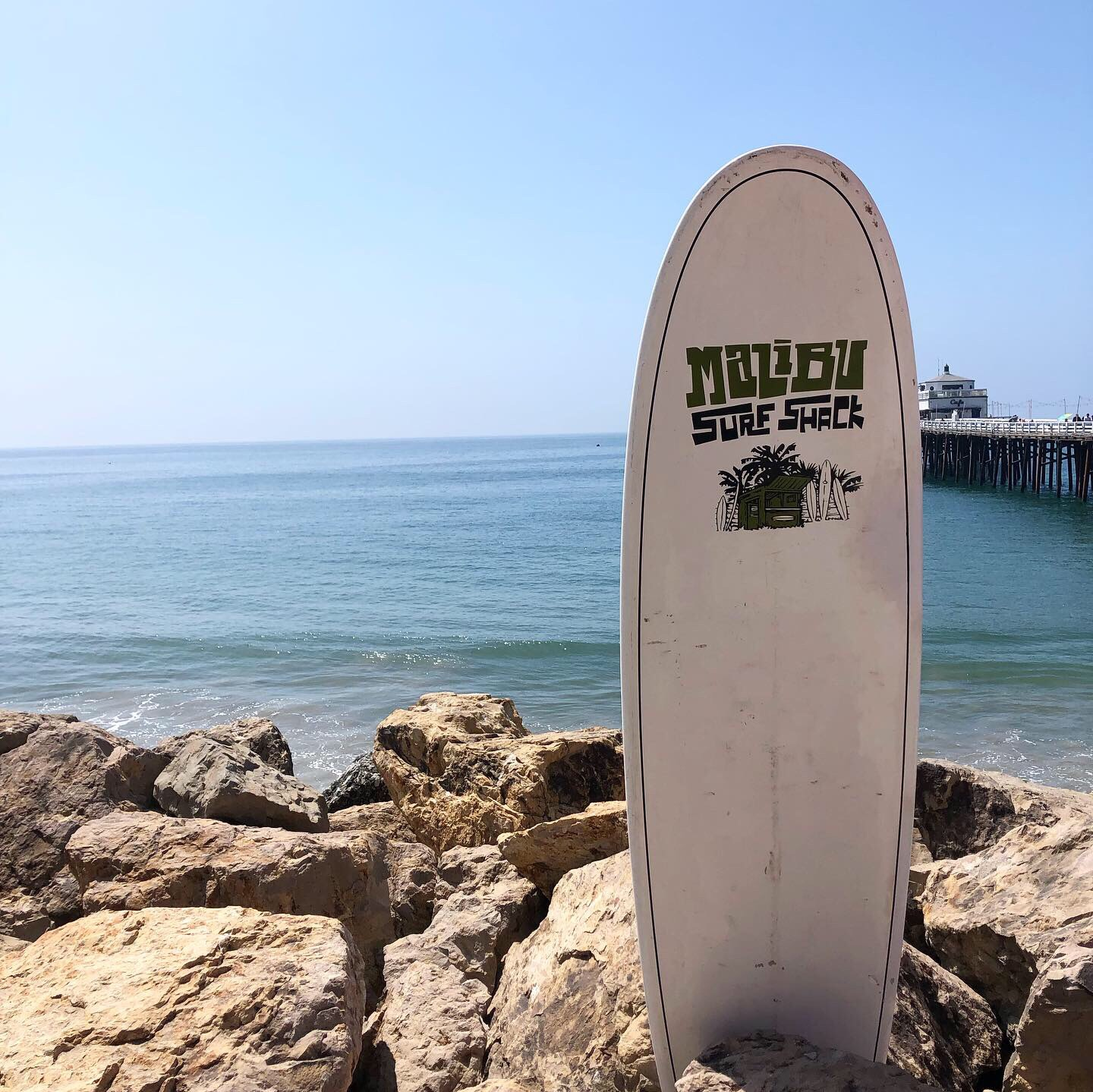 The Malibu Pier is perfect for views & photos. It's less touristy than the Santa Monica pier & perfect for watching crowds of surfers ride the waves!