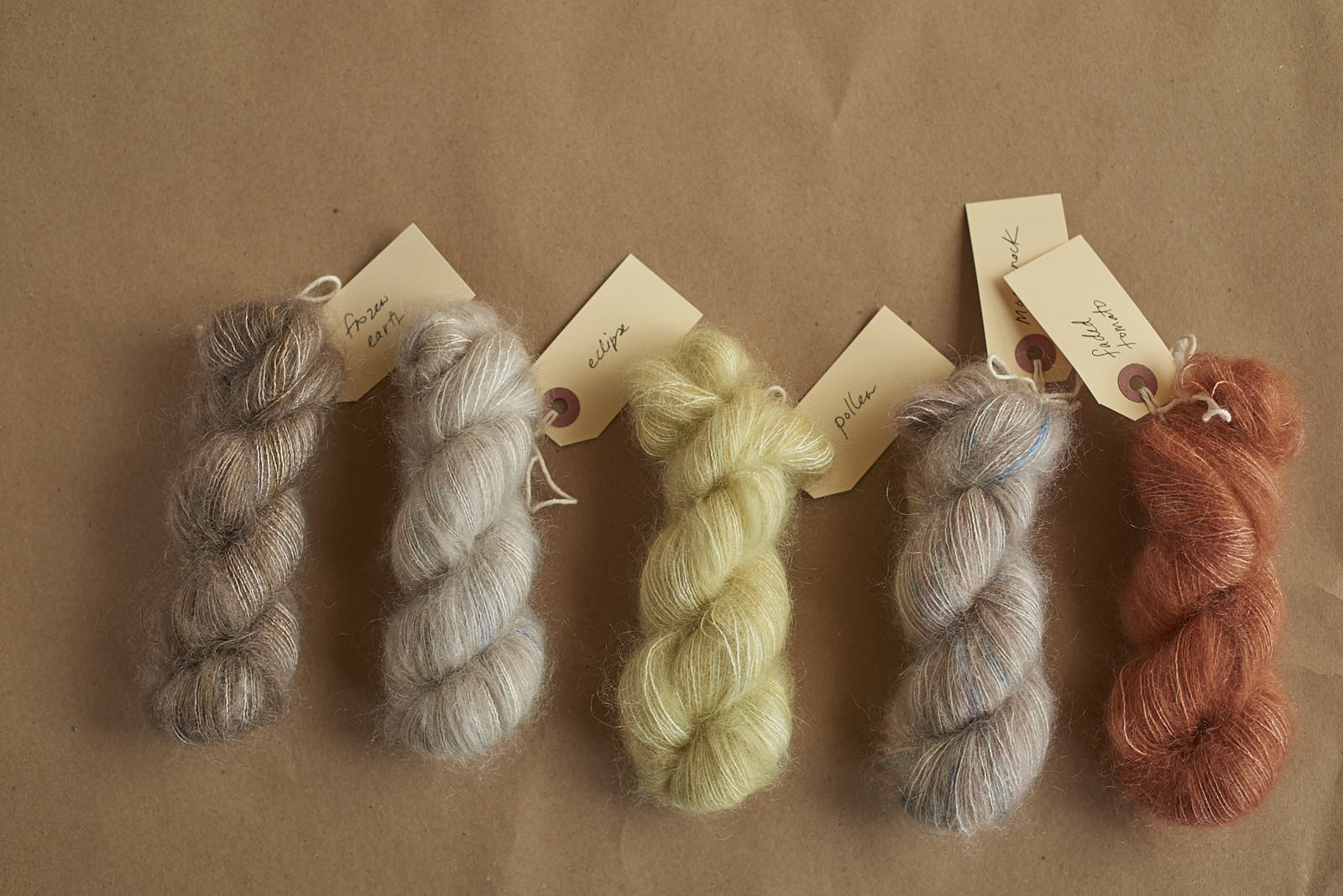 25g skeins of Mohair Lace intended for  Watashi no Yume  socks…there will be even more colours, but here's just a taste…  from left to right: Frozen Earth, Eclipse, Pollen, Moonrock & Faded Tomato