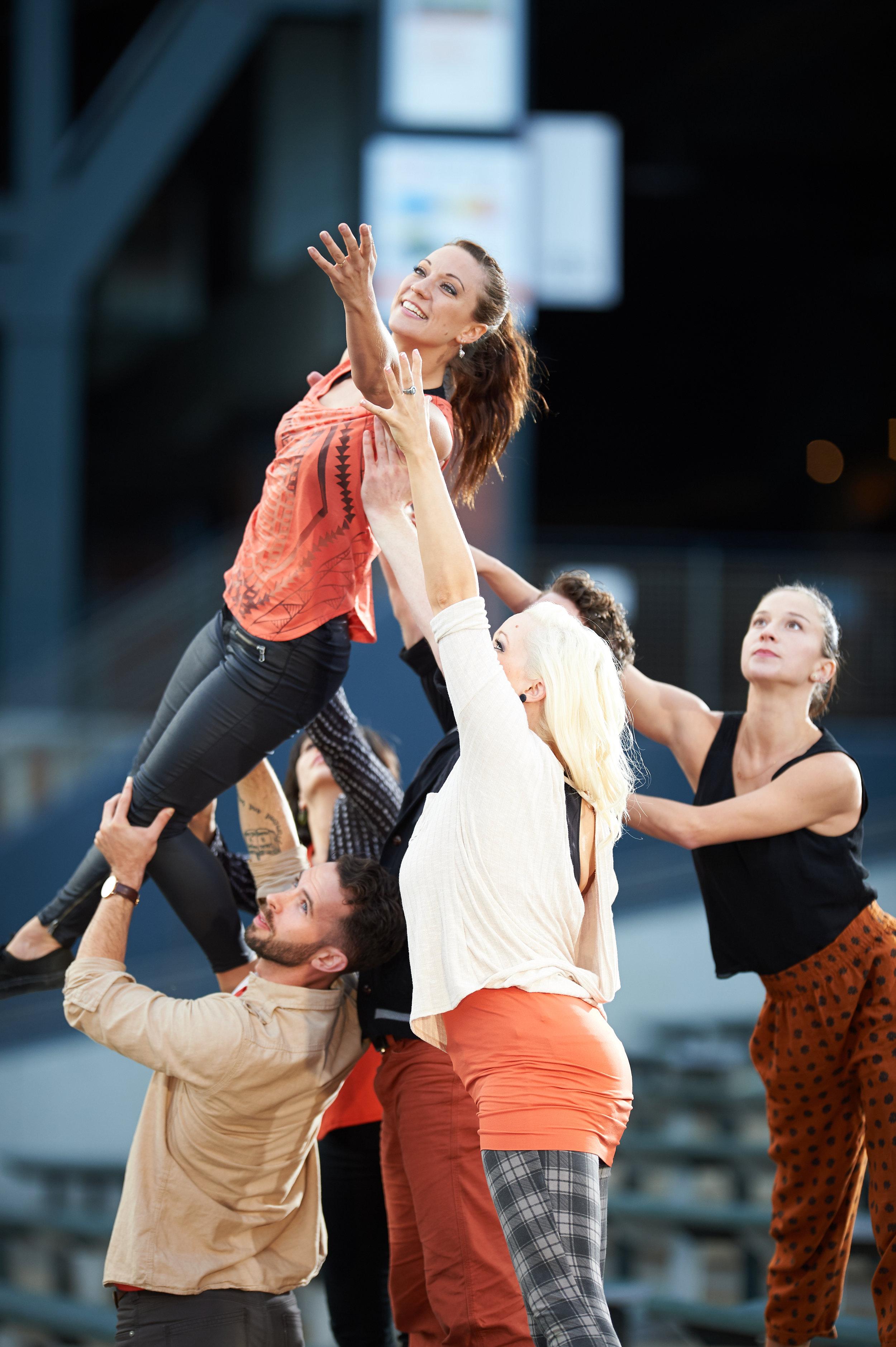 Erica Chipp and BaseBallet dancers in the bleachers [Photo by David DeSilva]