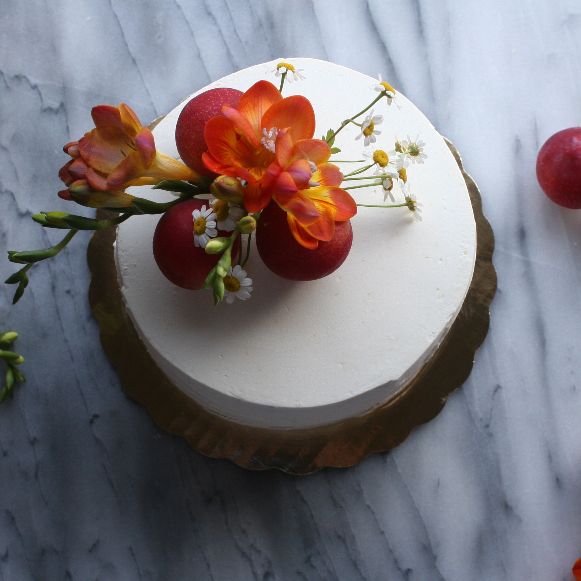 Summer cake styling inspiration with stone fruits and chamomile.JPG