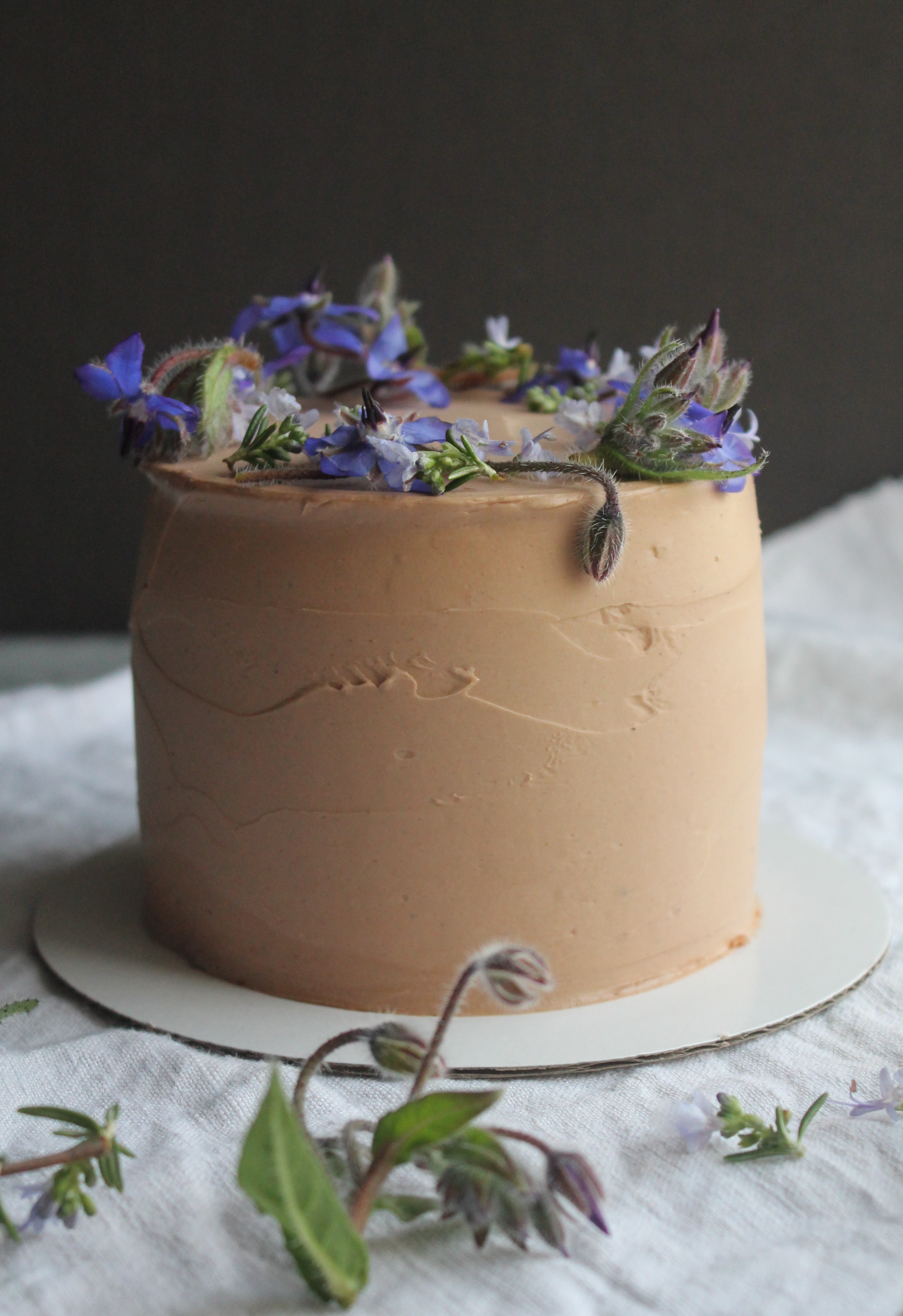chocolate cake with edible borage and rosemary flower for a little boy's birthday.