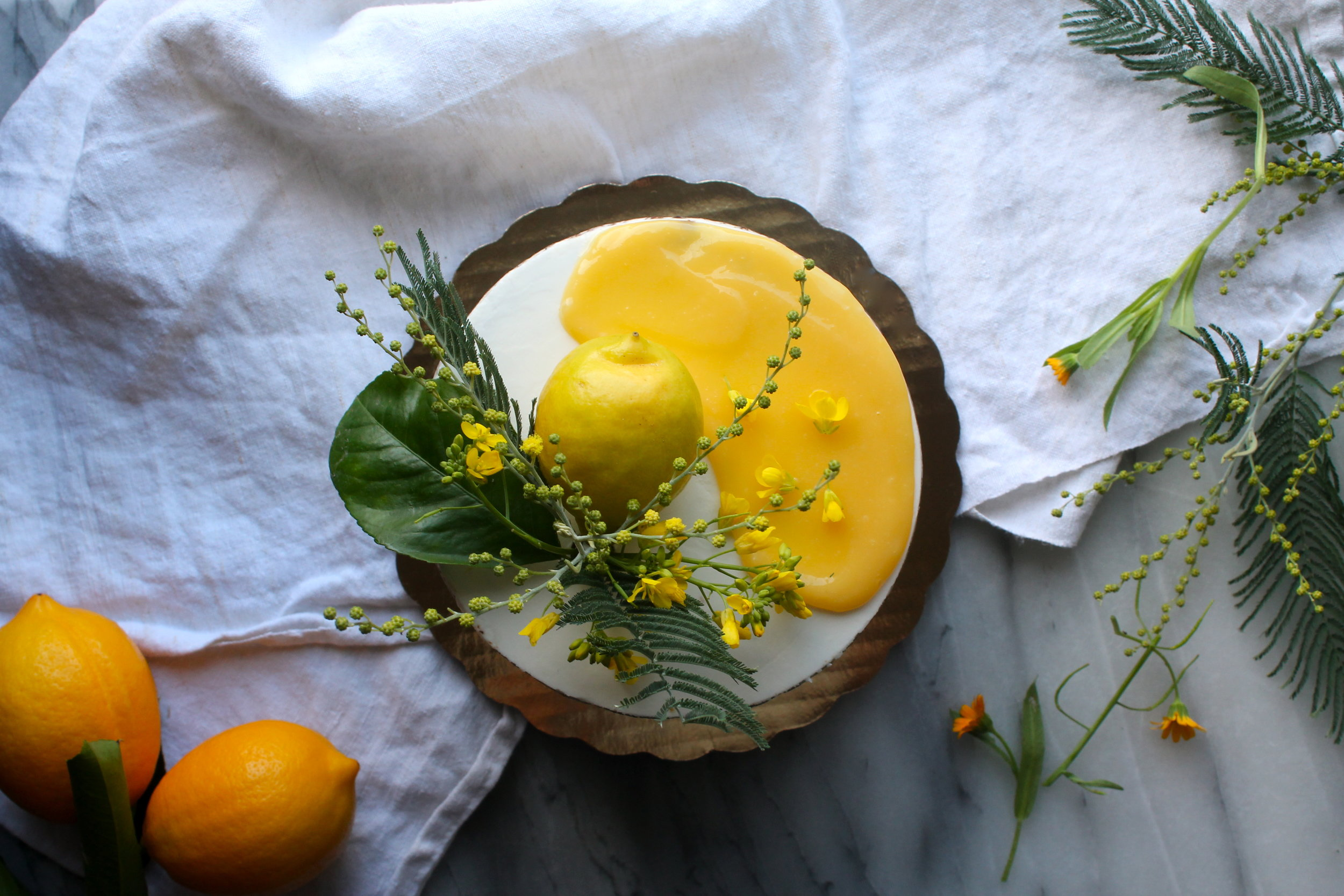 Meyer lemon curd cake with acacia + mustard flower