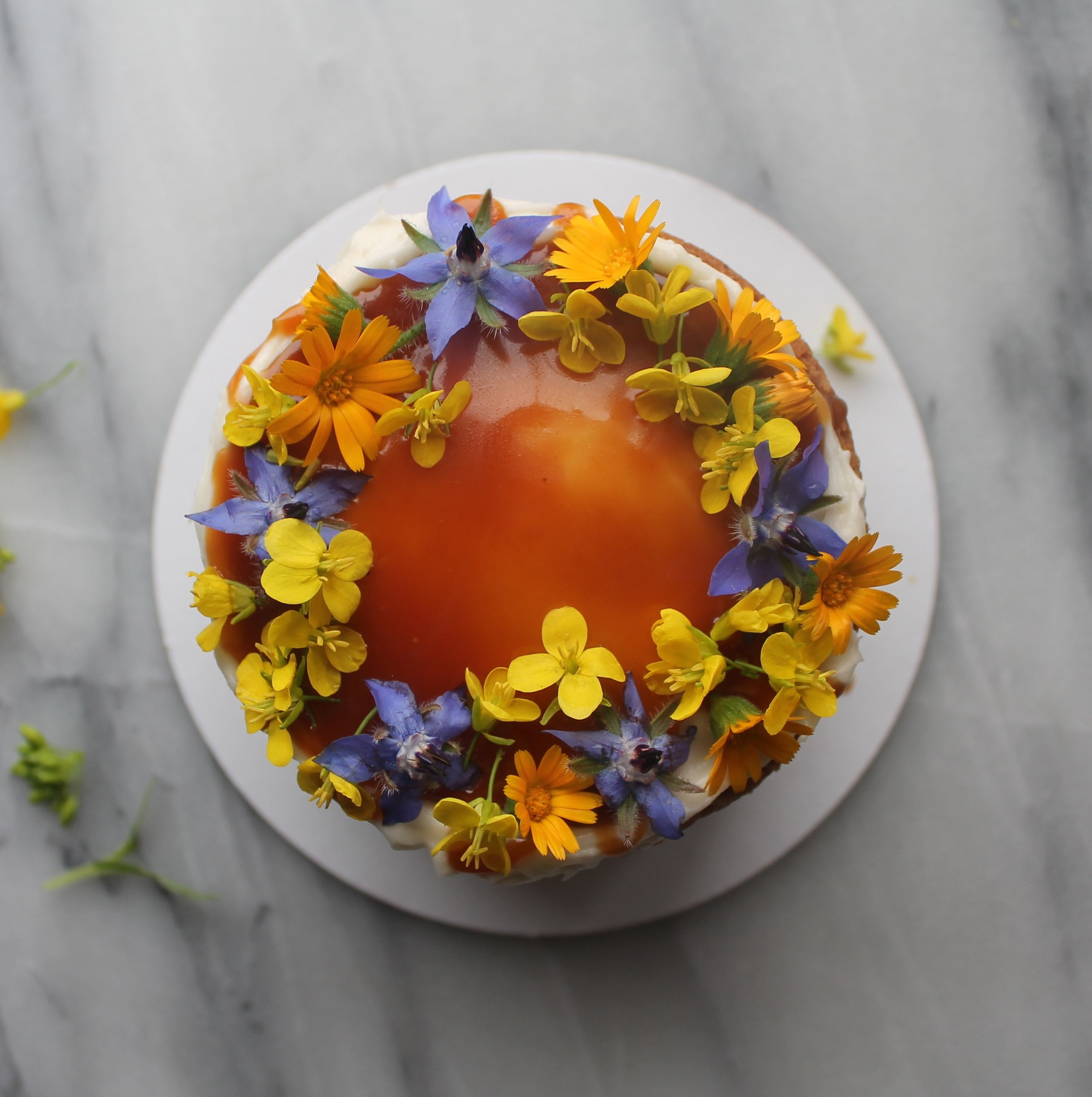 Edible flower cake with calendula, mustard, borage by Cake Bloom