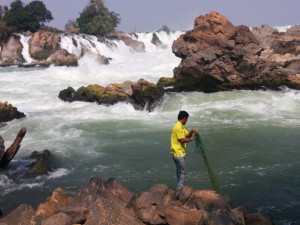A fisher in the Khone Falls area of Southern Laos, nearby to the location of the proposed Don Sahong dam on the Mekong River's mainstream (Photo credit: Carl Middleton)