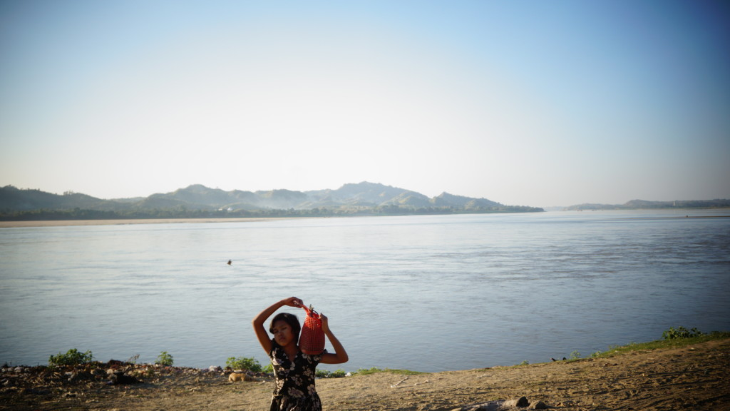 A girl fetching water from the Irrawaddy river
