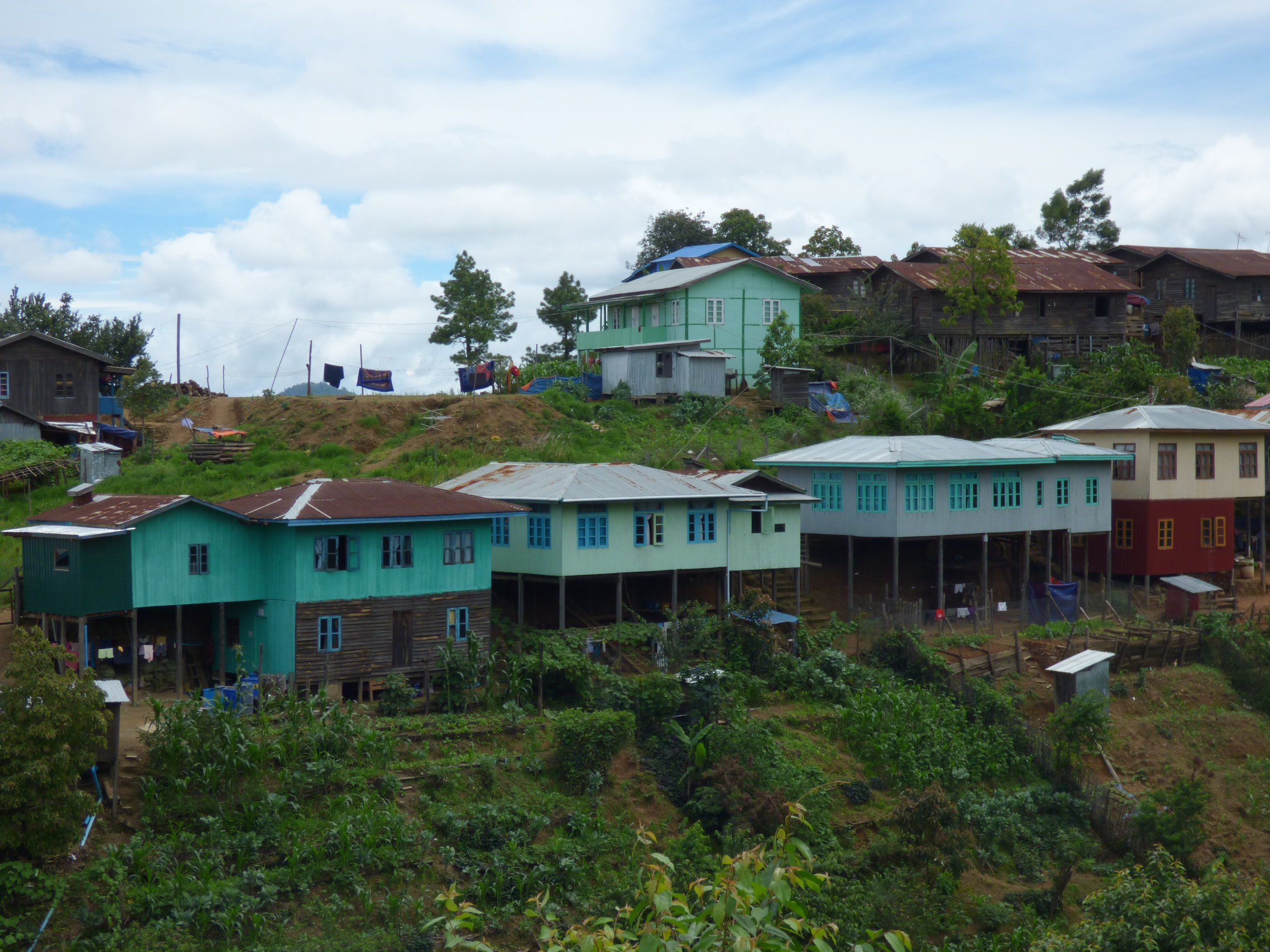 Houses perched in the watershed of the Rung Mountain, which decades ago was heavily forested and protected