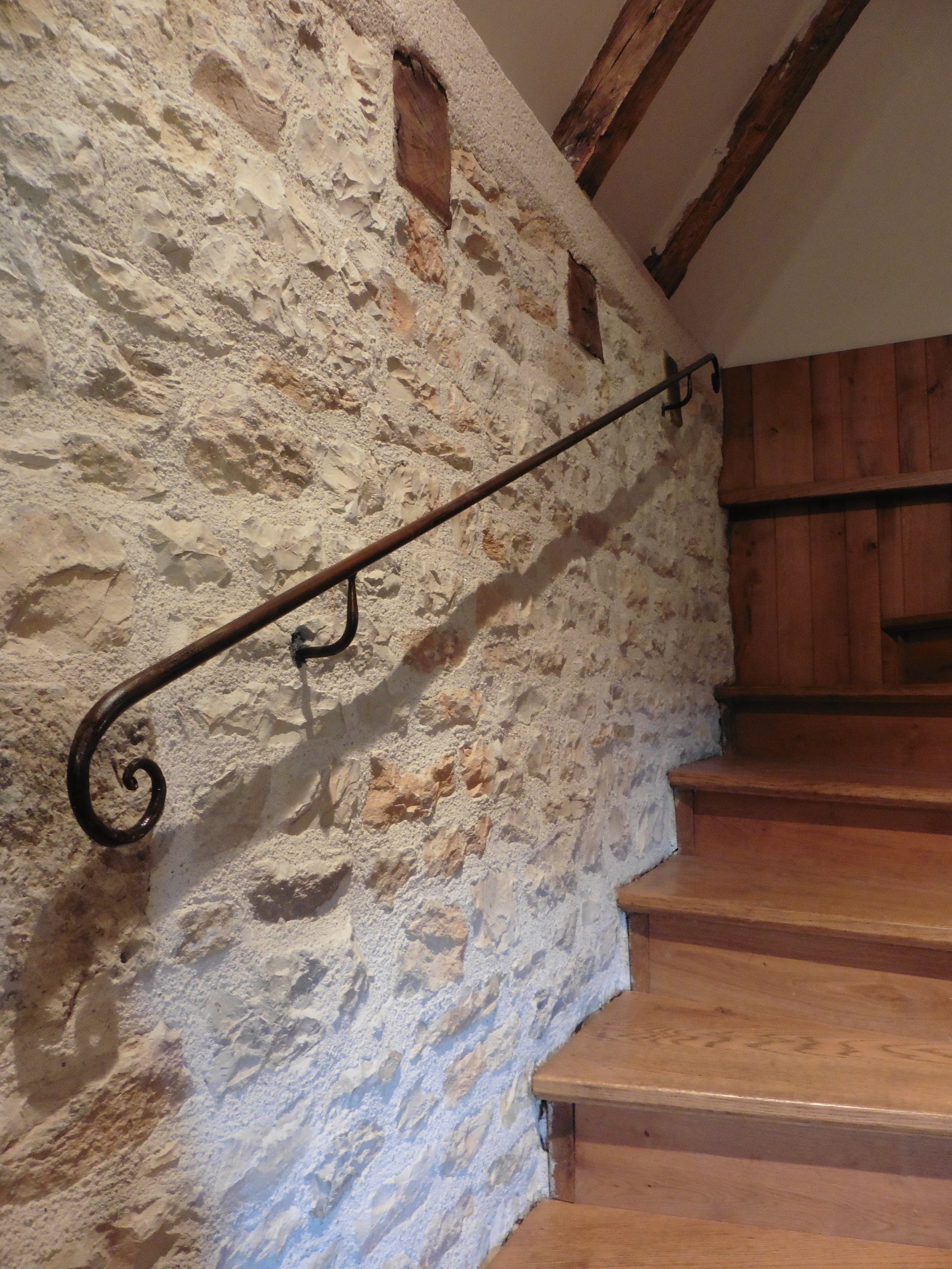 Handrail with a gentle curl at each end. Finished in a linseed oil-based product.