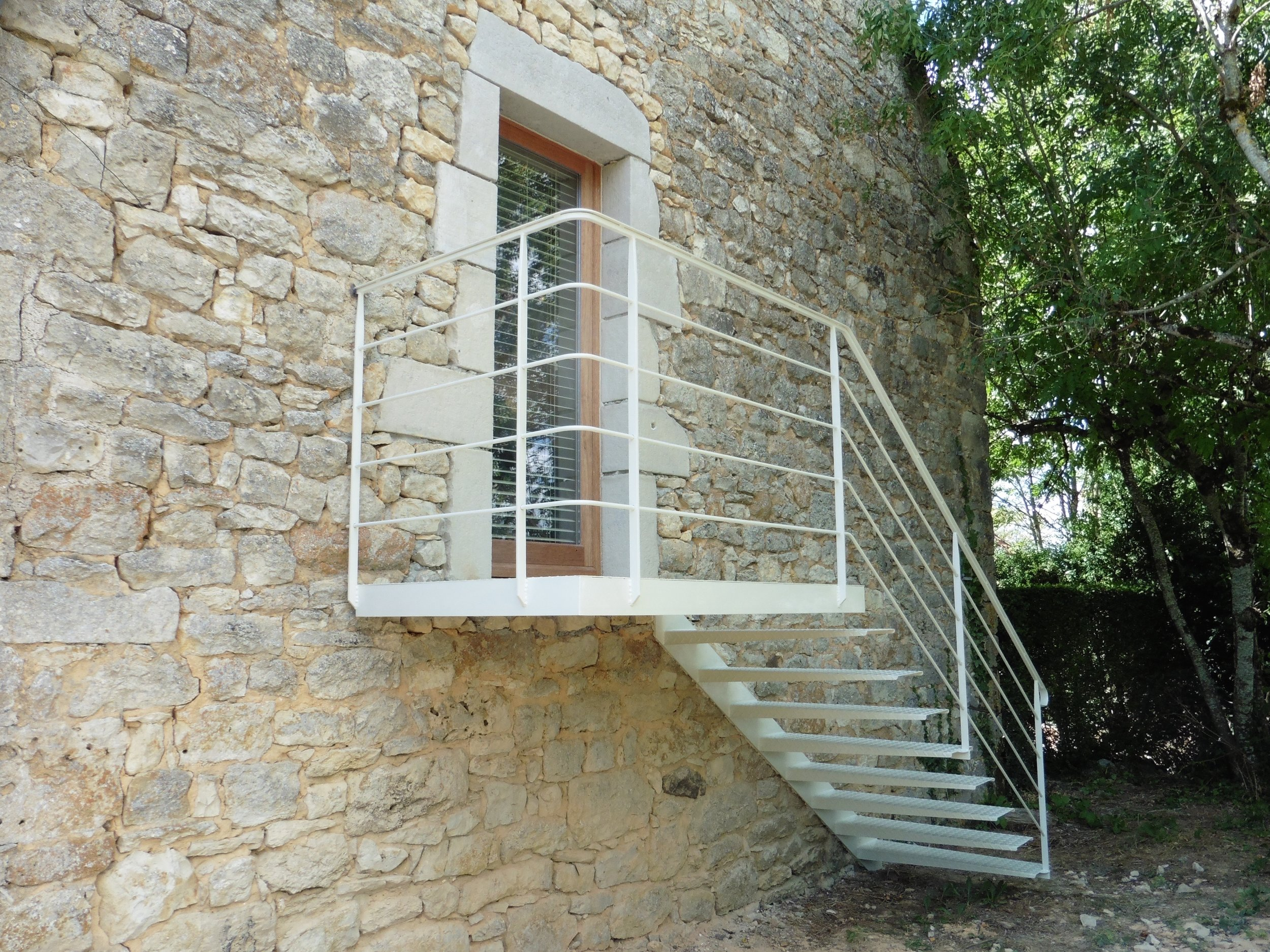 Very unusual 'floating' staircase leading down from a newly created exit. The paint colour harmonising beautifully with the old, stone walls.