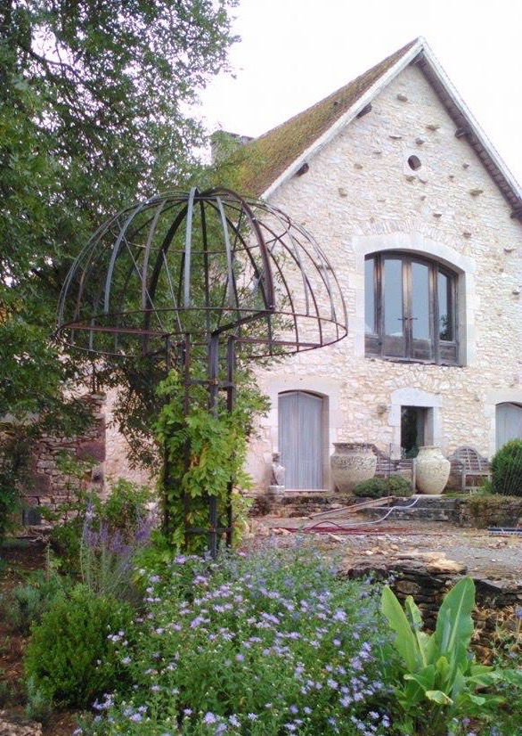 Glorious mushroom in metal for supporting a wisteria at a beautifully renovated barn.