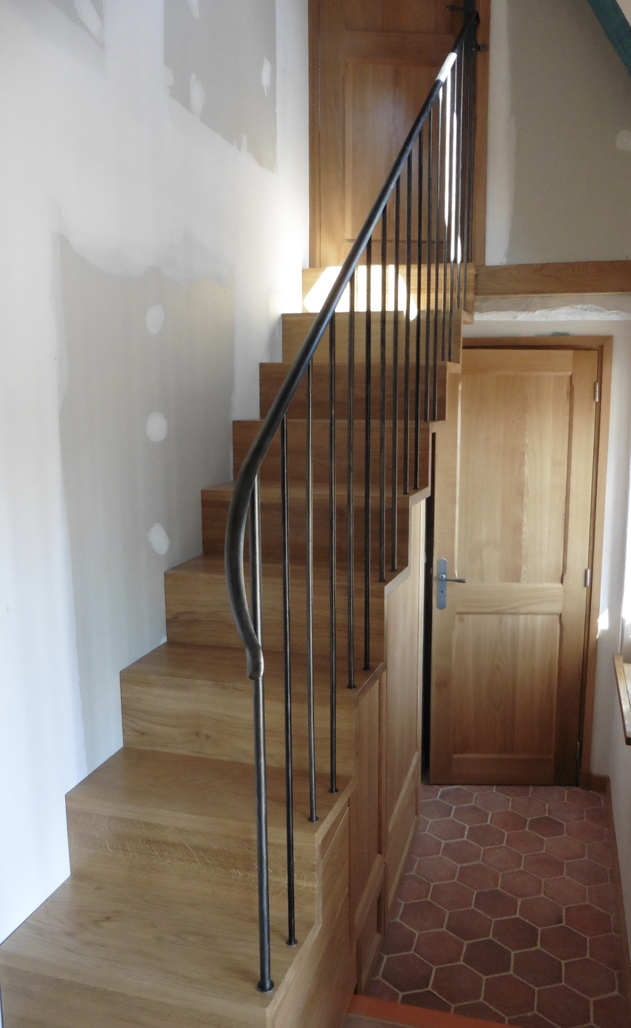 A lovely project - simple, uncluttered style railings on a Japanese style staircase with inbuilt under storage.