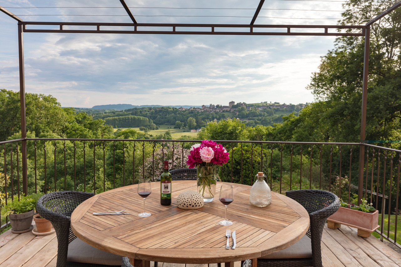The beautiful view from this terrace is a bonus and is framed beautifully by the uprights of the pergola.
