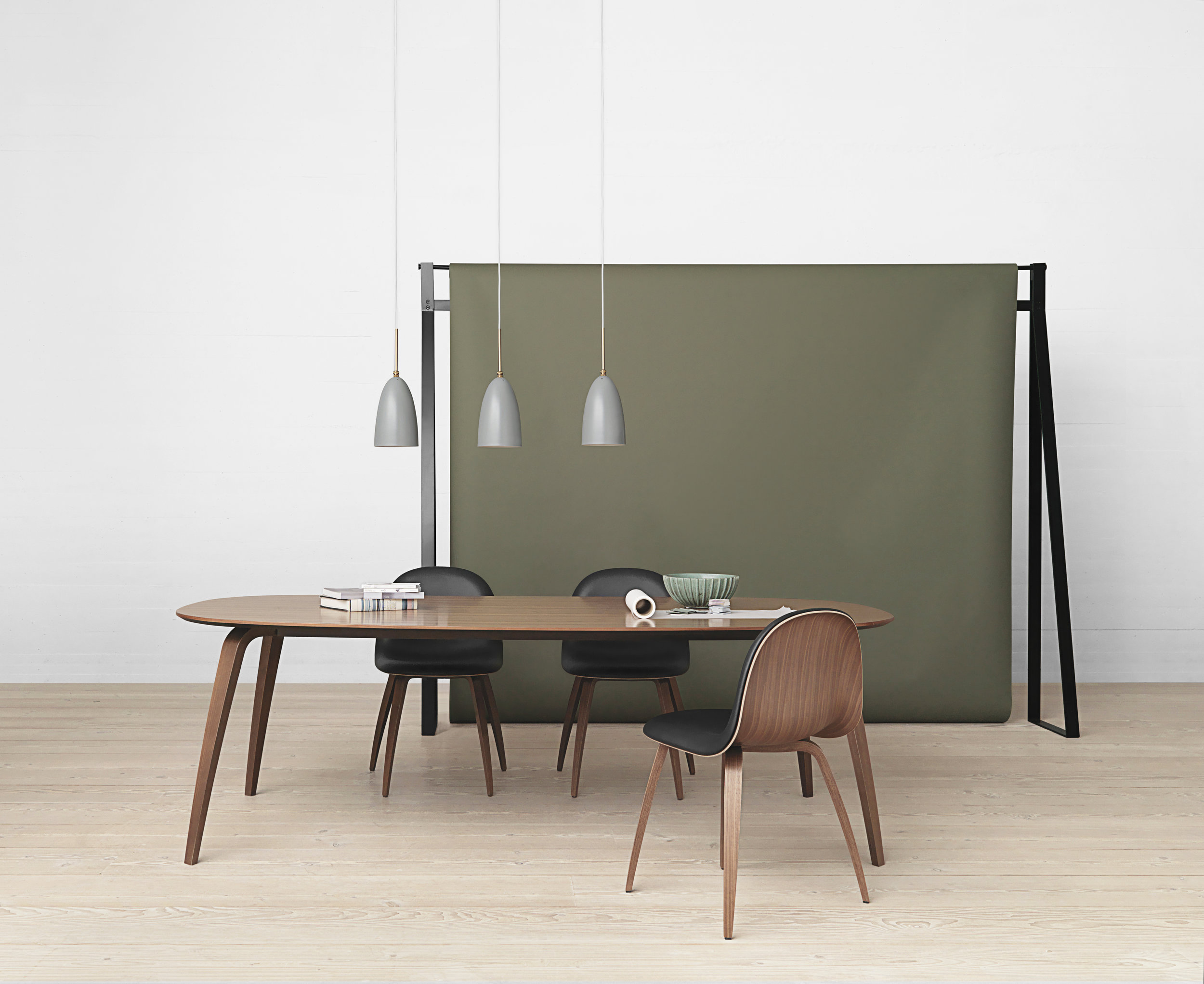 Gubi dining table - elliptical - walnut_Gräshoppa pendant - blue-grey_Gubi 52 chair - walnut and black leather.jpg