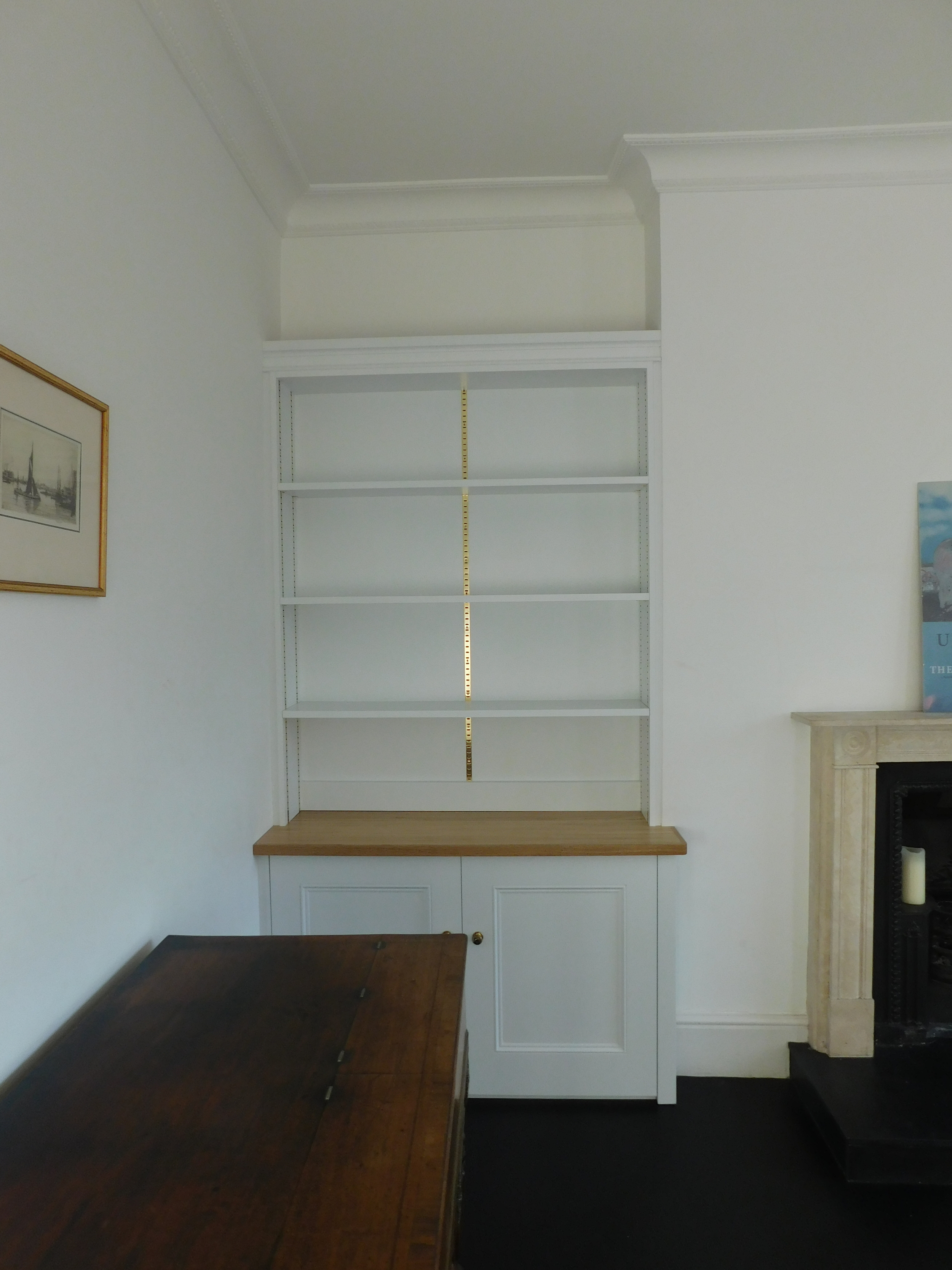Bookcase fitted with traditional, recessed polished brass, bookcase strips. fully adjustable.Fitted London 2016.