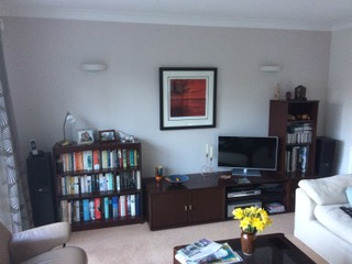 Before we started - Our clients wanted to update their existing sitting room furniture and replace it with something more unified and modern - and tailored to fit the space.