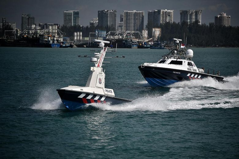 An Unmanned patrol boat leads the way off Singapore