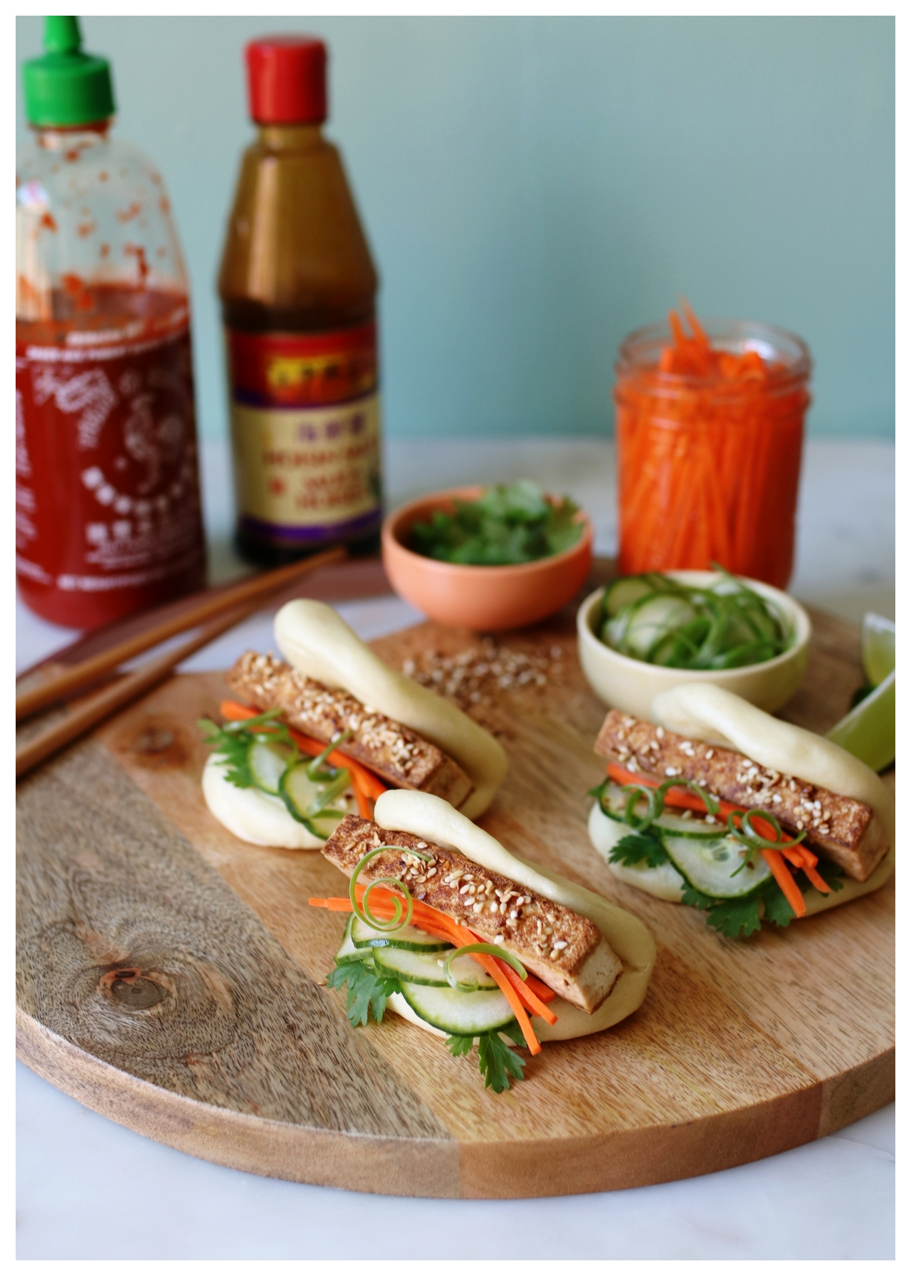 Clamshell Steamed Buns stuffed with sesame tofu, quick picked carrots, cucumber, and cilantro