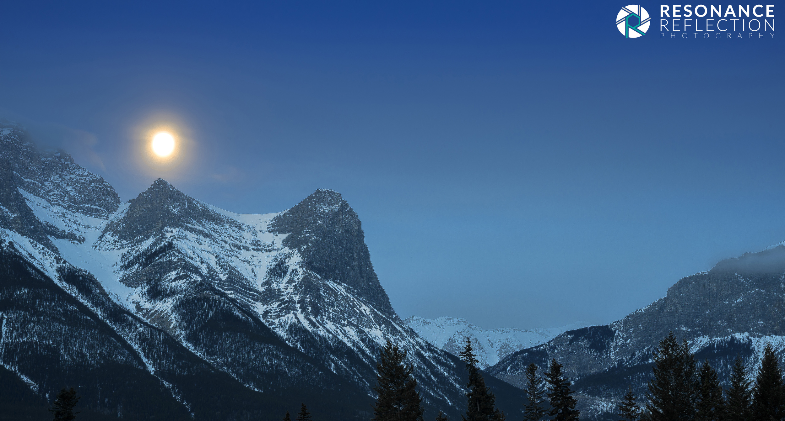 Moon Rising Over The Mountains