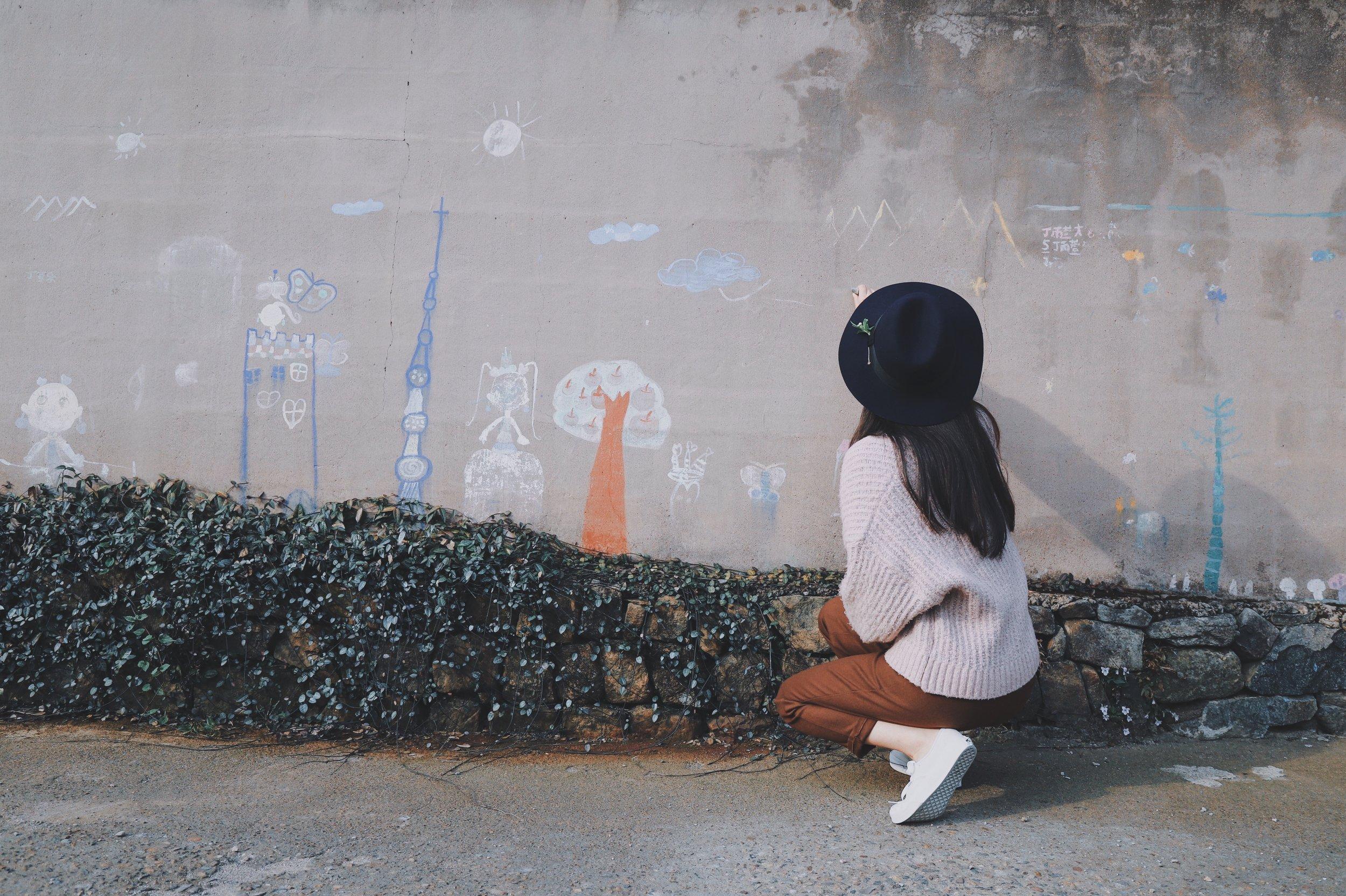 girl chalk painting on wall.jpg
