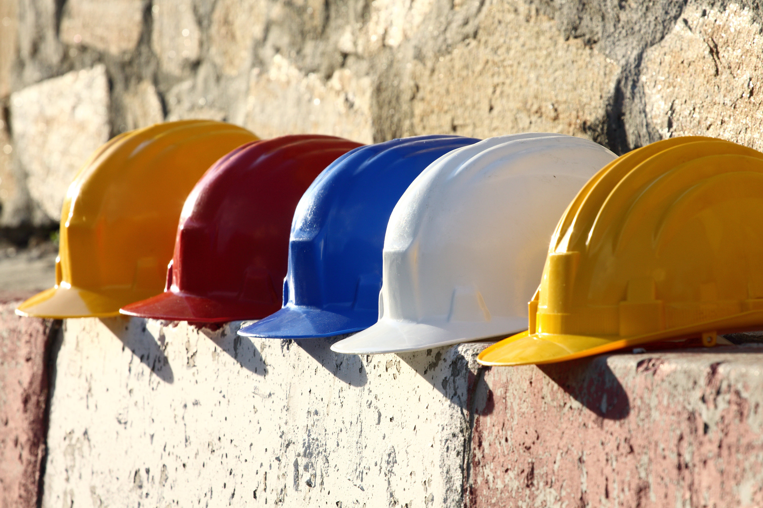 Construction Hard Hats in a Row