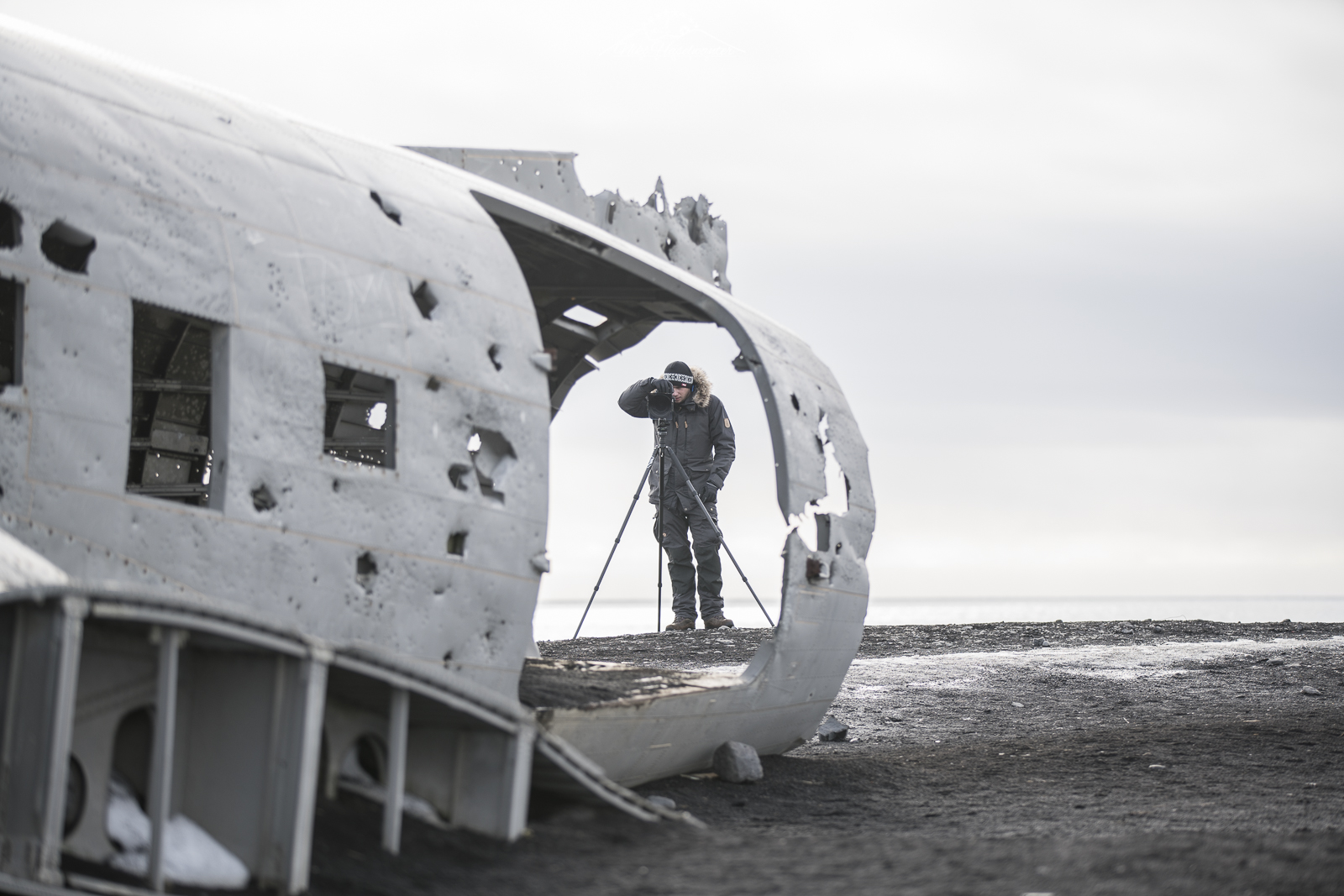 Christian Schipflinger photographing the famous plane-wreck of iceland