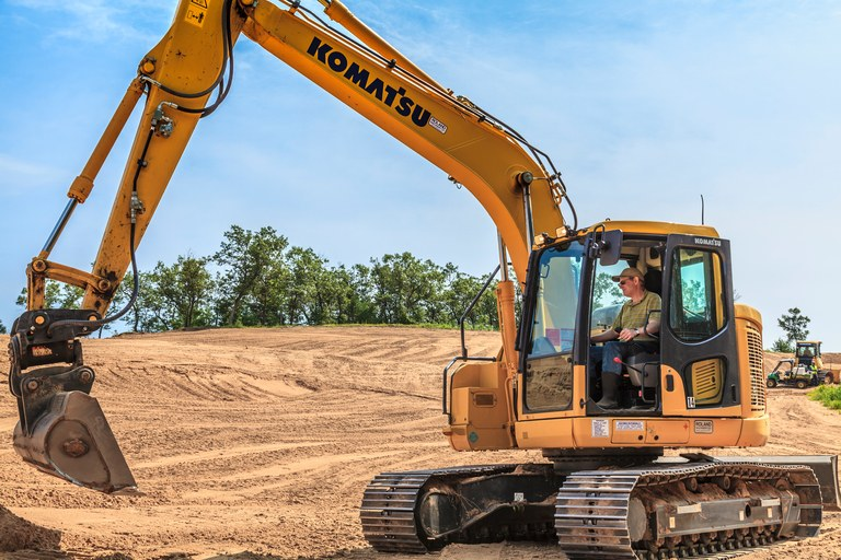 Brian Silvernail takes the driver's seat in an excavator (photo by Ryan Farrow)