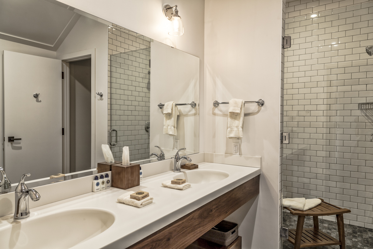 A view of the Double Vanity Sink in the bathroom of the Lodge Single King Rooms