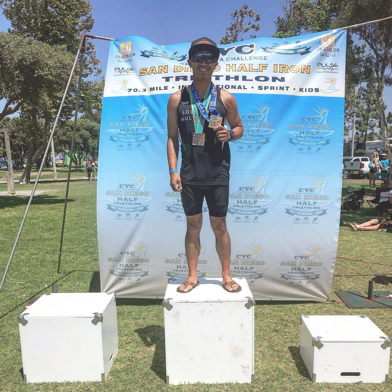 """SBMS Athlete Andrew Rioveros, pictured above after taking 1st place in the 20-24 Age Group at the Chula Vista Challenge Sprint Triathlon. Trained by Coach Zack.  """"South Bay Multi Sport has brought me up to new levels of accomplishments in the sport of triathlon. The coaches know exactly what it takes for each individual athlete to reach their full potential. Under the coaching of Zack hammer, I was able to PR and place top ten in my age group for the 2016 Mission Bay Triathlon for the first time since 2012. Furthermore, I placed 1st in my age group at the 2016 Chula Vista Challenge Sprint Triathlon which qualified me for the Age Group National Championships. My favorite part about being in this family of athletes is the encouragement and motivation you get on and off season. Coach Zack and Coach Josh work hard to see their athletes take on PR's and podiums."""""""