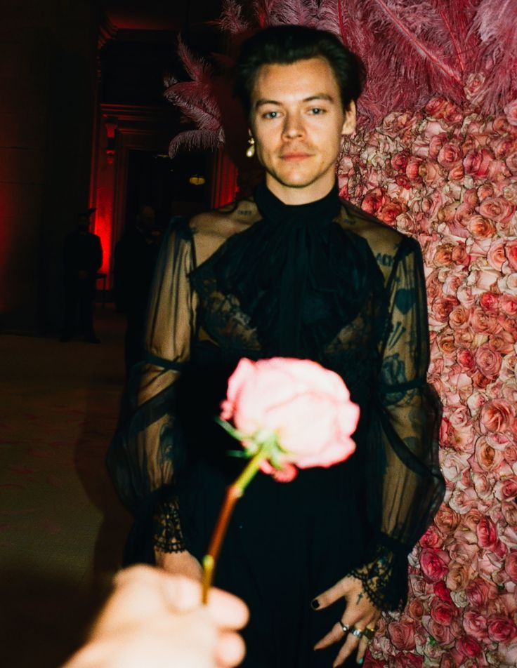 Harry Styles  - exempt from the black tux rant by virtue of his high-waisted trousers, sheer blouse, black nail polish and peal earring (and also the fact he co-chaired the event)
