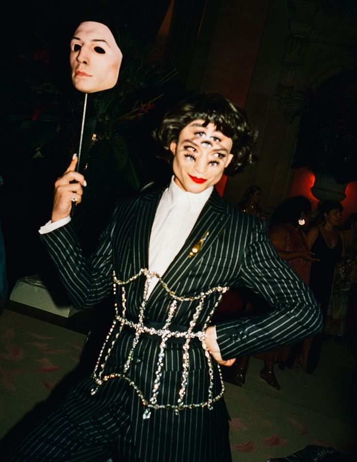Ezra Miller -  also exempt from the black tux rant. In a custom pin-stripped Burberry suit, complete with train, jewel encrusted corset, mask, and 7 eyes, Ezra's outfit was anything but safe.