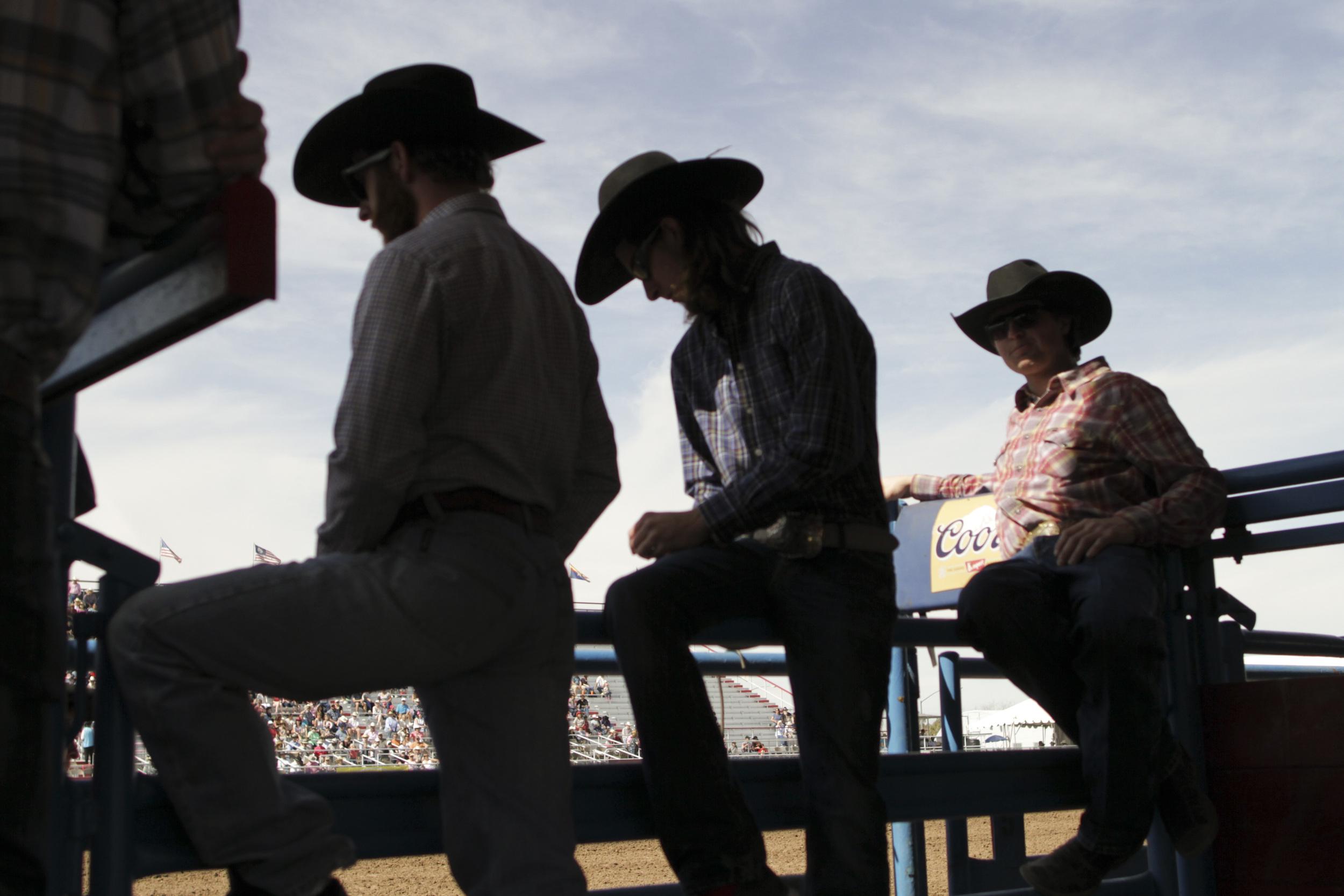 Cowboys watch the Fiesta de Los Vaqueros in Tucson, Arizona in February 2014.