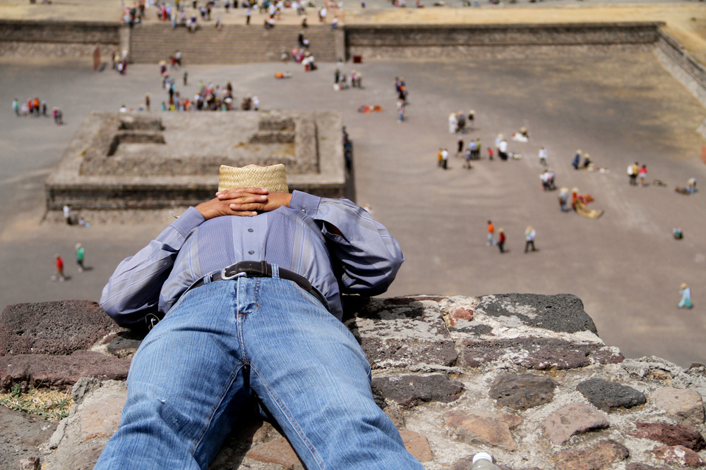 A man takes a break halfway up one of the pyramids at Teotihuacán in March 2014.
