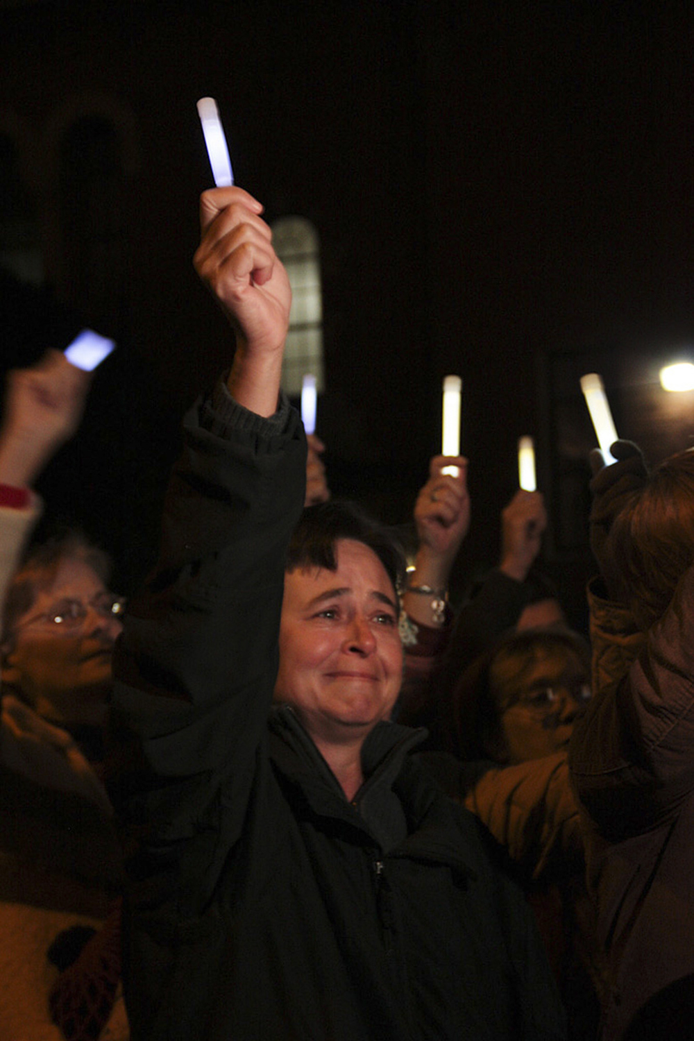 Kelly Griffith raises her glowstick at the candlelight vigil one year after the Jan. 8, 2011 shooting killed six people and injured 13, including then-Rep. Gabrielle Giffords in Tucson, Arizona.