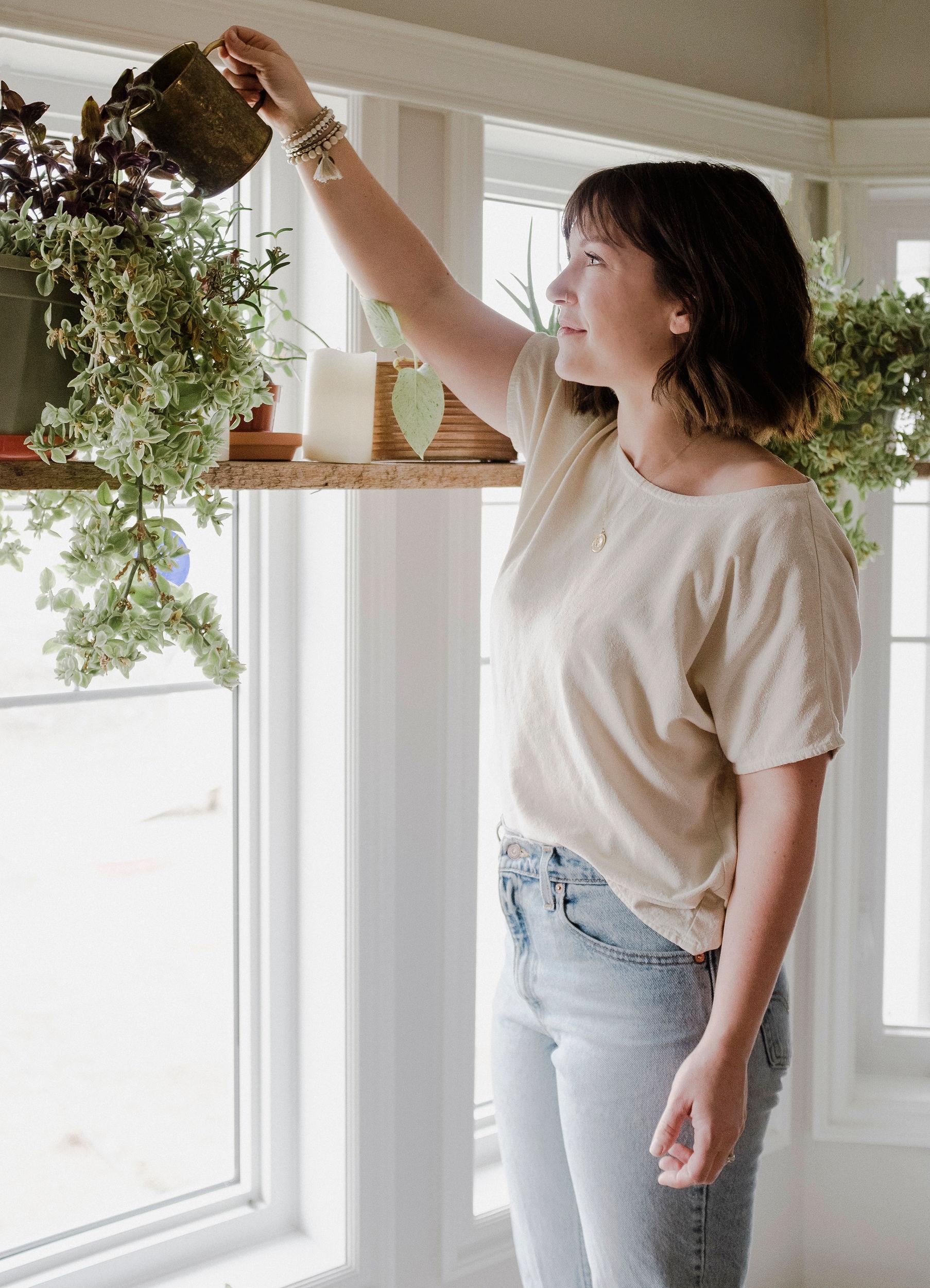 Karmen waters her plants in  Volerra bracelet set  from the shop.