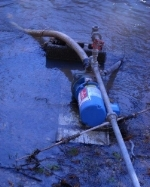 home utilizing water from a creek to stop and get a well drilled for domestic use.jpg