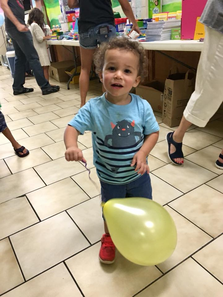 Give this cutie a balloon and he will smile all night!— with  Kissy Padron .