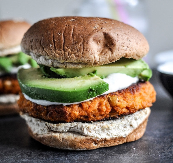 These smoky sweet potato burgers would be a great use of some of your next box, right? Photo by Jessica of  How Sweet Eats