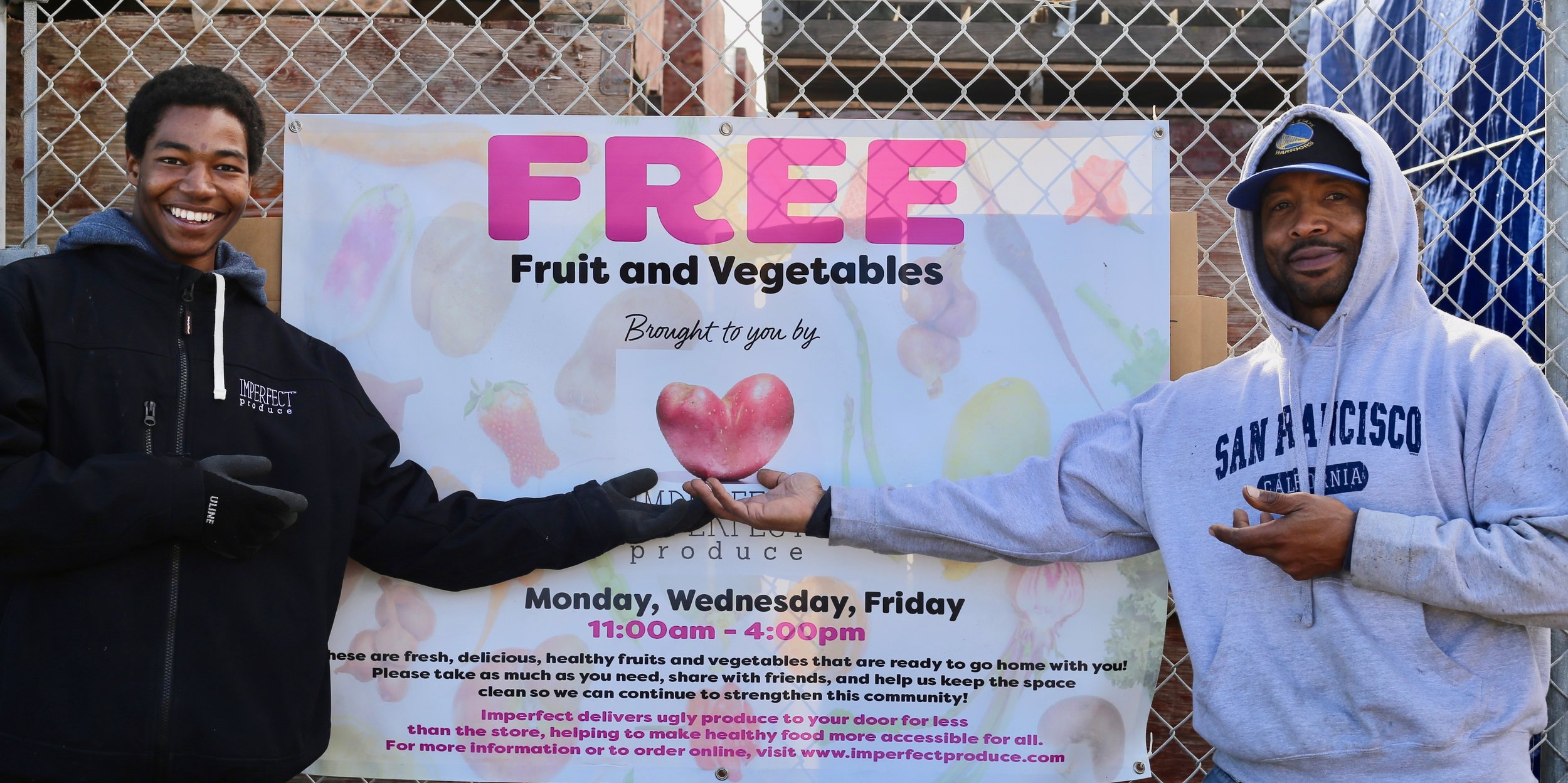 Jessie McDowell and Andre Vinent welcome community members to our free farmers market every week.
