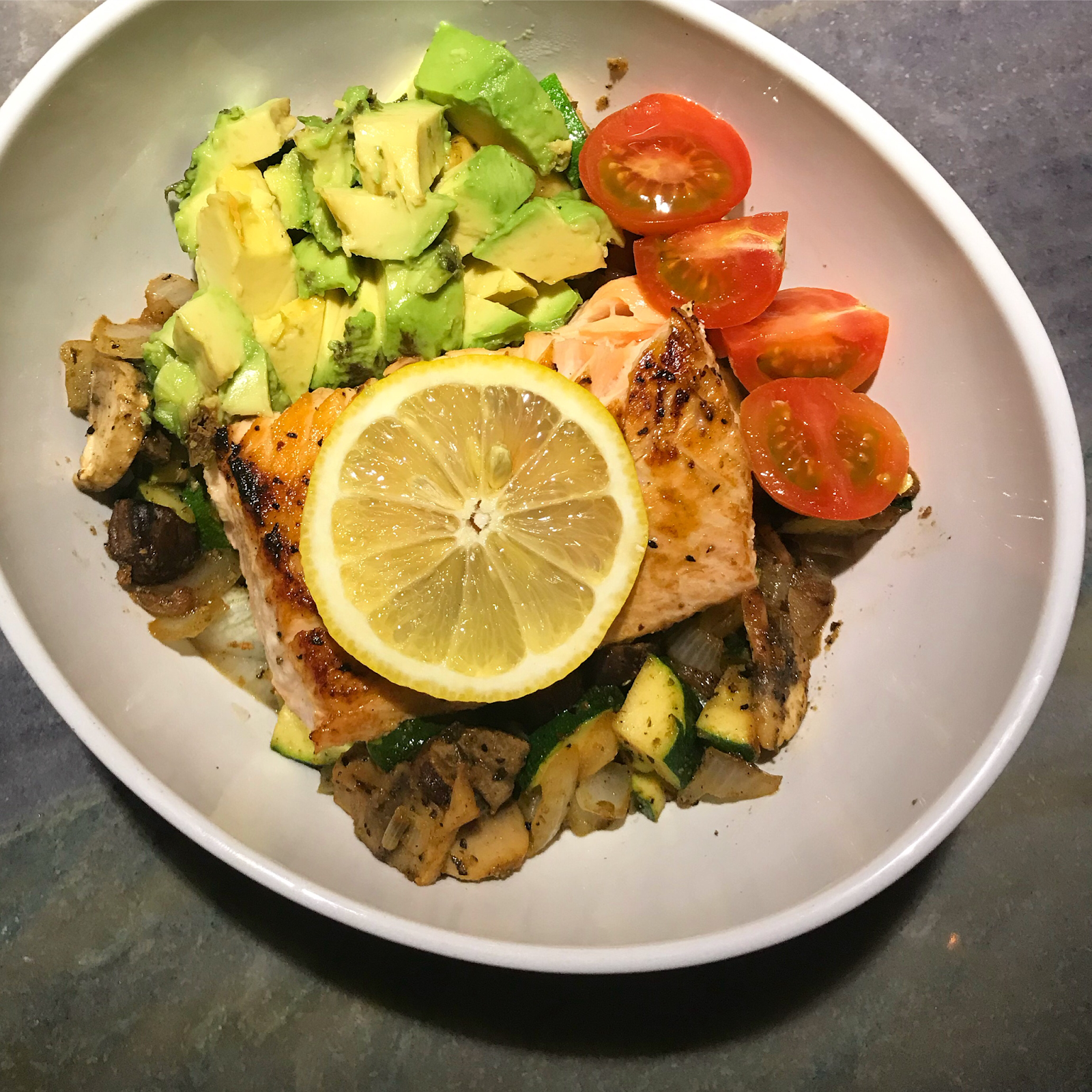 Stir fry topped with 4-5 oz salmon fillet cooked with lemon, avocado and cherry tomatoes!