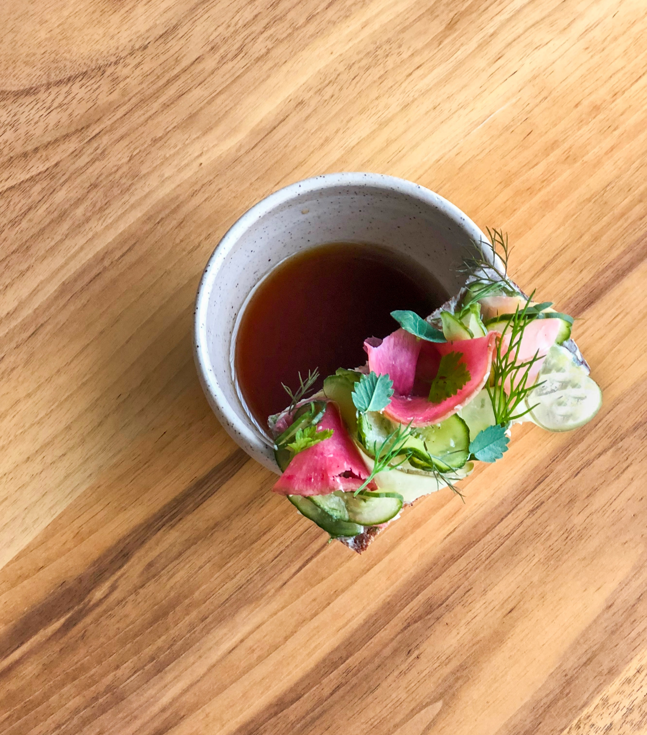 Tea of lightly smoked Imperfect fruits and vegetables, with radish toast