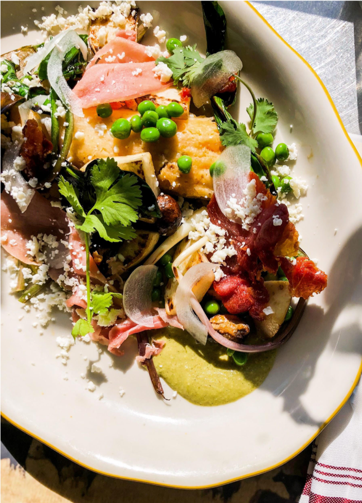 Sweet corn tamal with country ham, spring vegetables, queso fresco and Imperfect onions