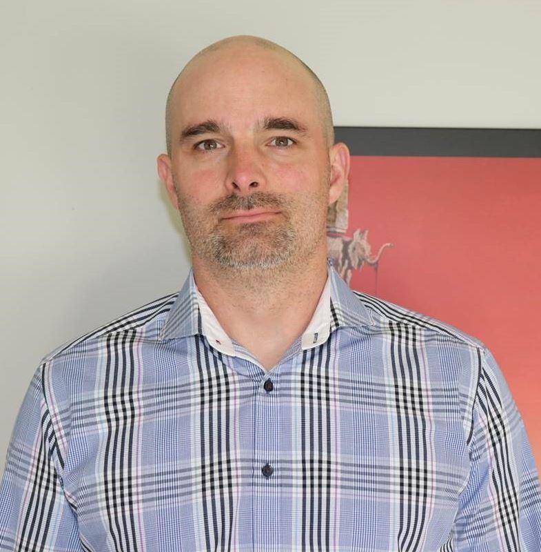 Craig Comstock Headshot (B&W).png