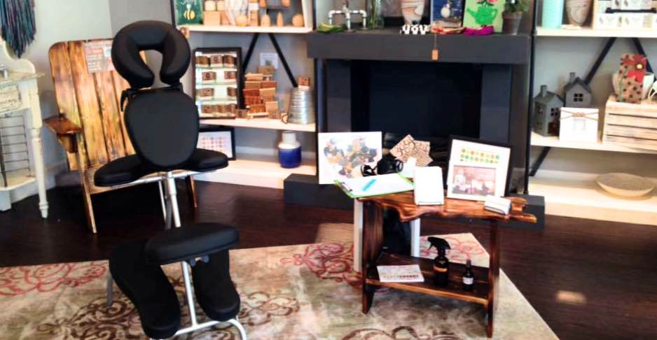 Niasoma Bodywork providing chair massage at Gallery U Boutique
