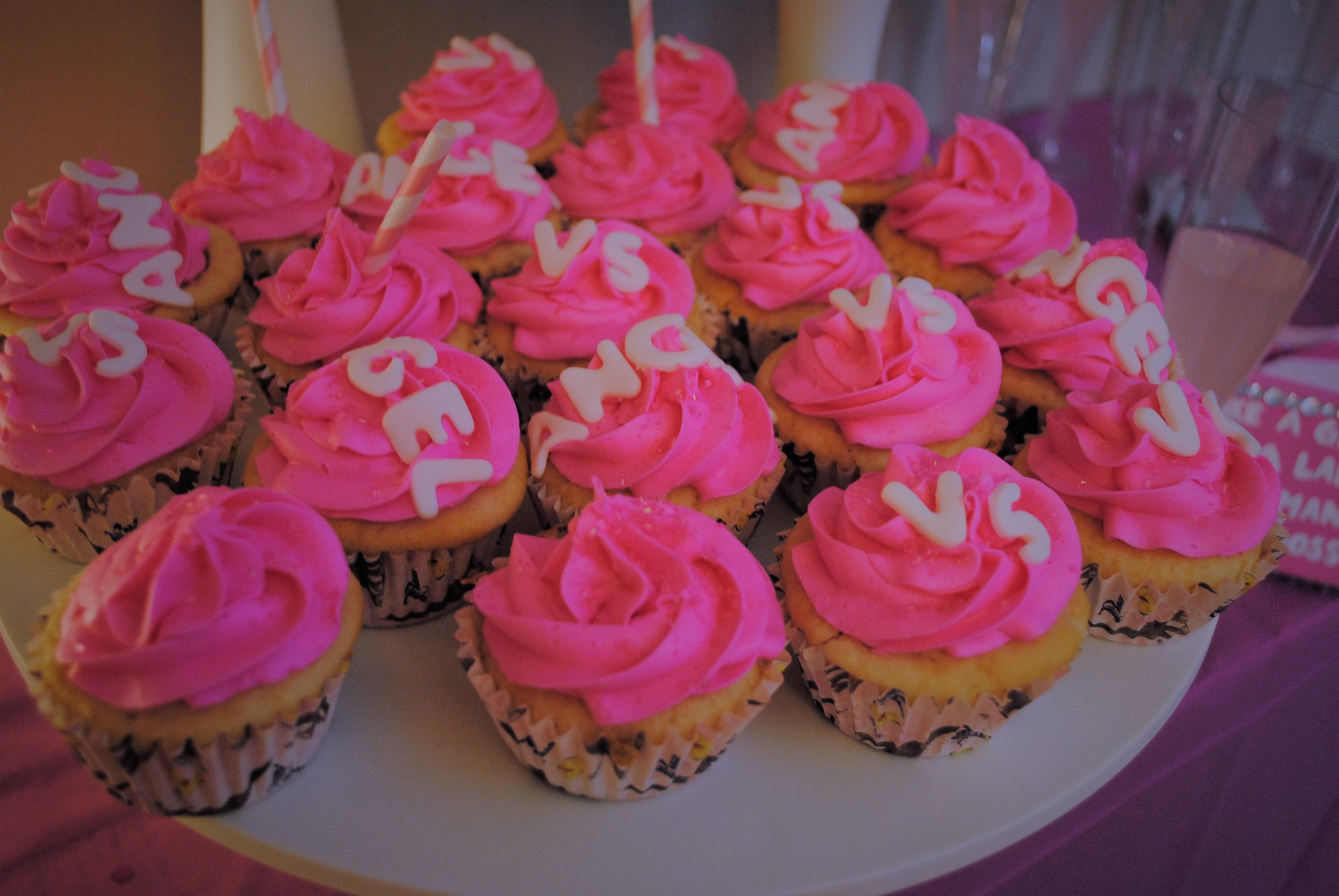 """The cupcakes spelled out """"VS"""" and """"ANGEL"""""""