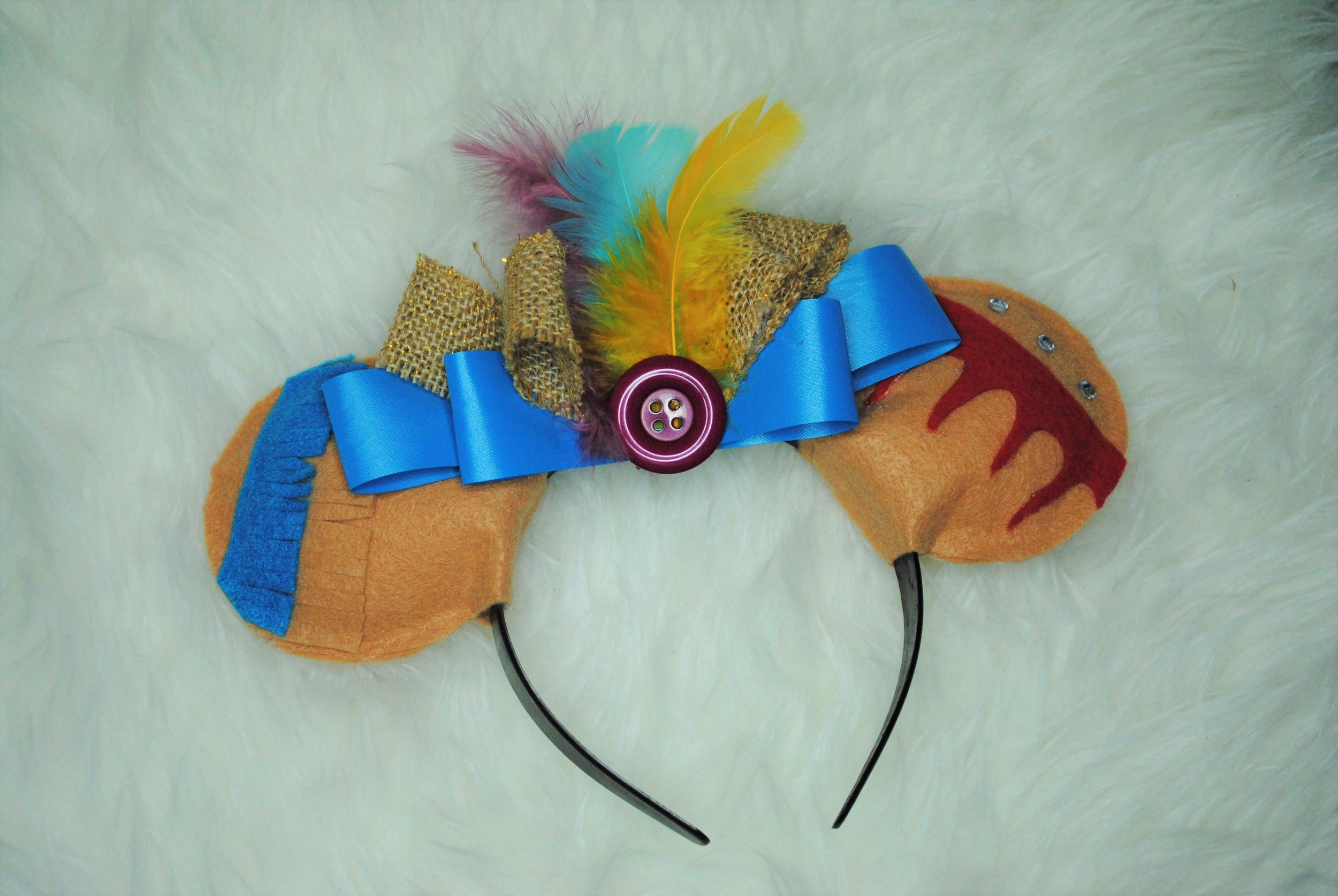 POCAHONTAS EARS! These ears were super avant-garde and flashy, but I think they stayed pretty true to Pocahontas at the same time. I thought adding the burlap to the bow in the center looked really good with the bright feathers, so I'm happy with the way these ones came out!