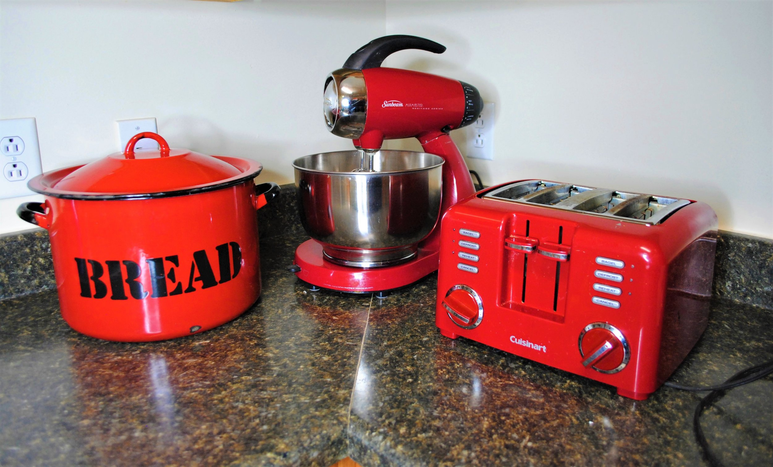 My wonderful parents gave me these kitchen appliances after they moved. While I love each of the pieces, I knew the cherry red color would clash with the rest of my apartment. But have no fear, spray paint Tess is here!