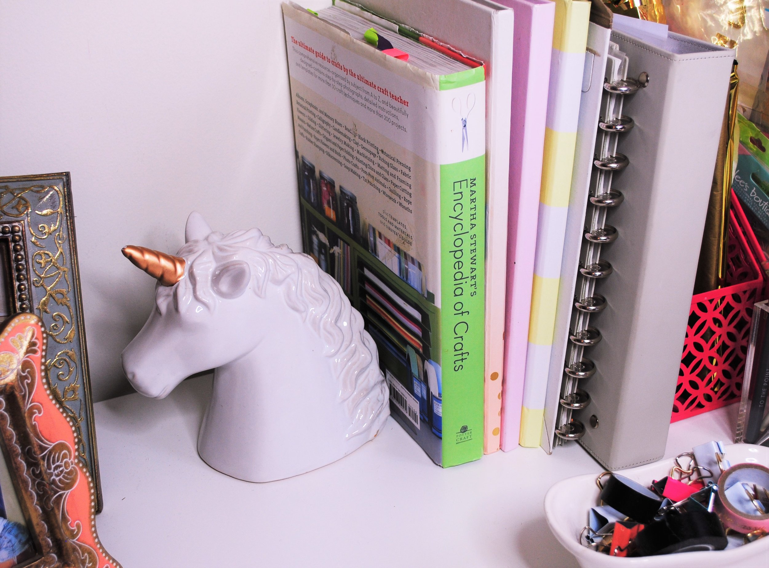 It's not complete without a unicorn! - I found this ceramic unicorn head at Marshall's for $6 which is a total steal, and I use it to prop up all of my favorite craft books and binders.