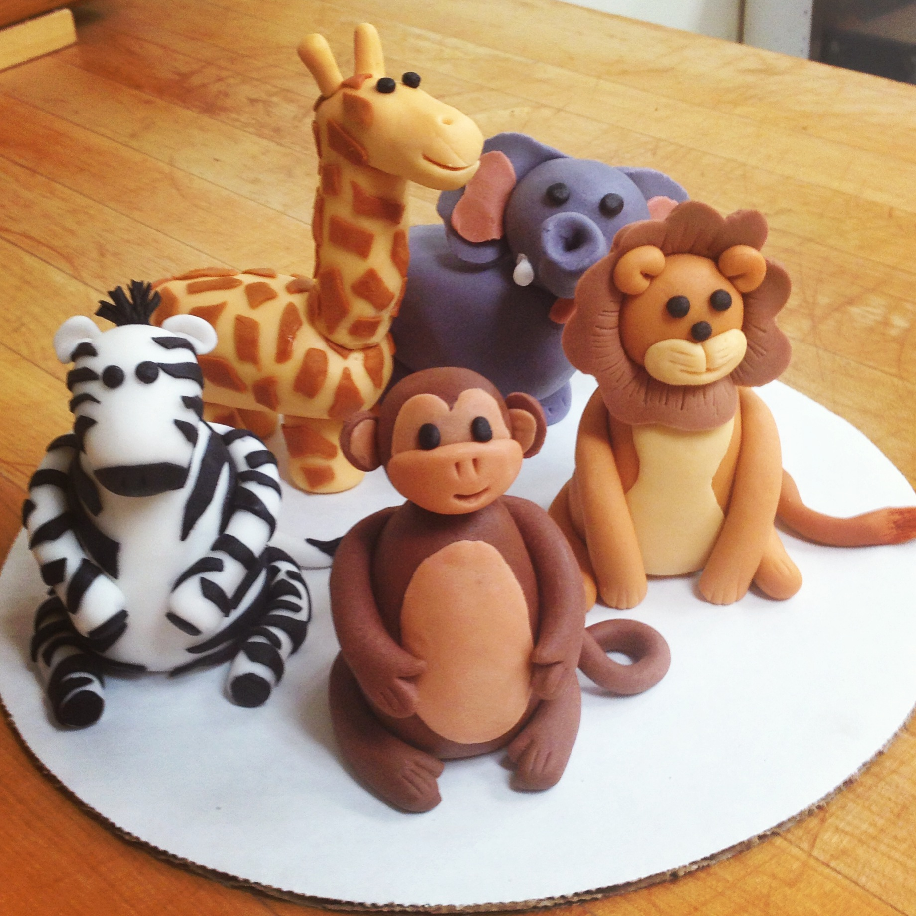Hand sculpted fondant figures for an animal themed cake