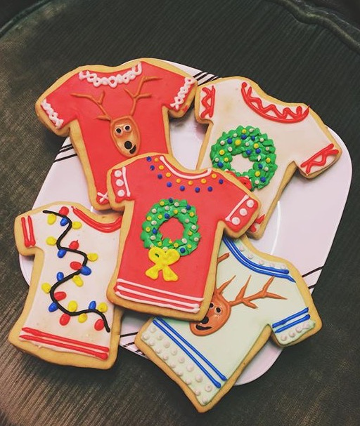 Custom iced sugar cookies with ugly Christmas sweater designs