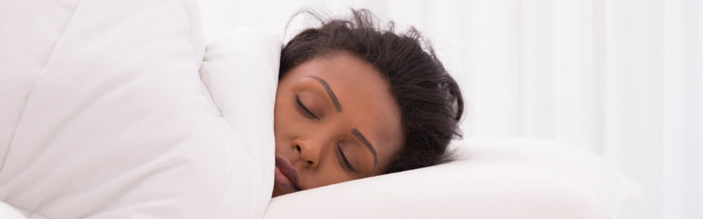 woman-sleeping-on-pillow-picture-id602308056.jpg