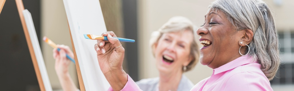 two-senior-women-having-fun-painting-in-art-class-picture-id541586172.jpg